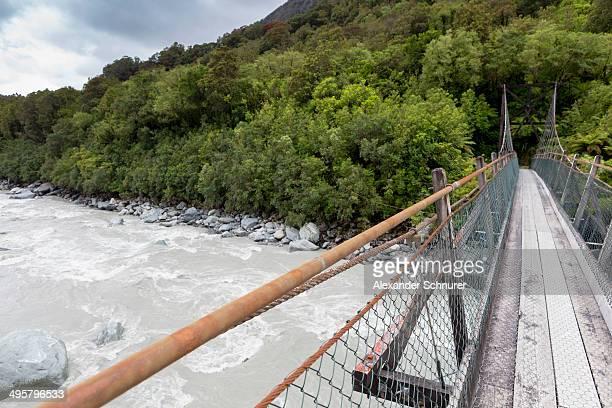 Narrow suspension bridge over the Fox River, Fox River, West Coast Region, New Zealand