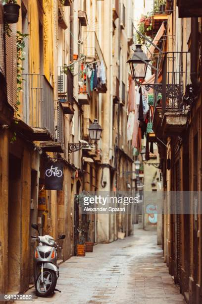 Narrow winding street in Barrio Gotico (Gothic Quarter) in Barcelona, Catalonia, Spain