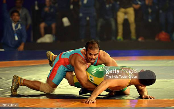 Narsingh Yadav going against Mongolian wrestler Purevjav Unurbat during the Pro wrestling league in New Delhi