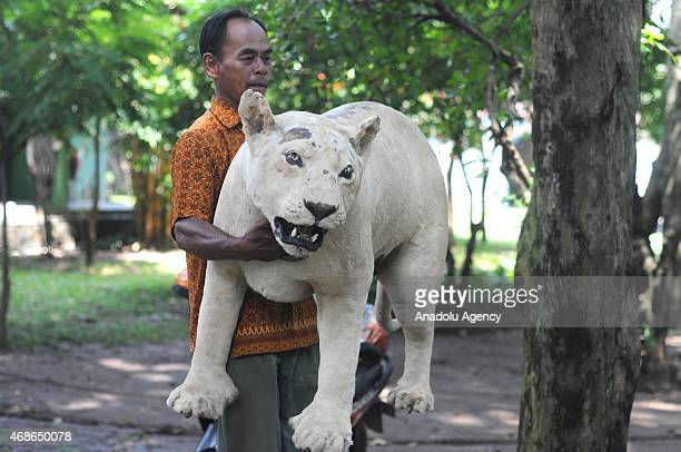Narto a zoo keeper holds a stuffed animal at the Jurug Zoo in Surakarta Central Java Indonesia on April 05 2015 Jurug Zoo displays stuffed version of...