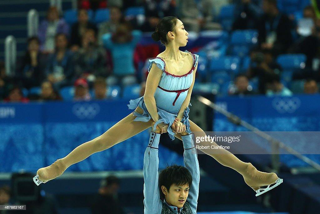 Narumi Takahashi and Kihara Ryuichi of Japan compete in the Figure Skating Team Pairs Free Skating Program during day one of the Sochi 2014 Winter...
