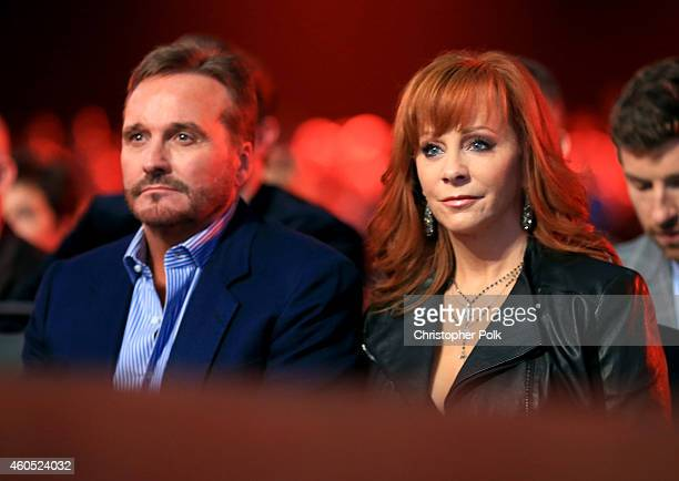 Narvel Blackstock and Reba McEntire attend the 2014 American Country Countdown Awards at Music City Center on December 15 2014 in Nashville Tennessee