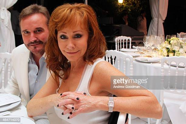 Narvel Blackstock and Reba McEntire attend the White Party Dinner Hosted by Andrea and Veronica Bocelli Celebrating Celebrity Fight Night In Italy...