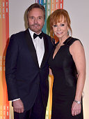 Narvel Blackstock and Reba McEntire walk the red carpet during the 27th Annual Kennedy Center Honors at John F Kennedy Center for the Performing Arts...