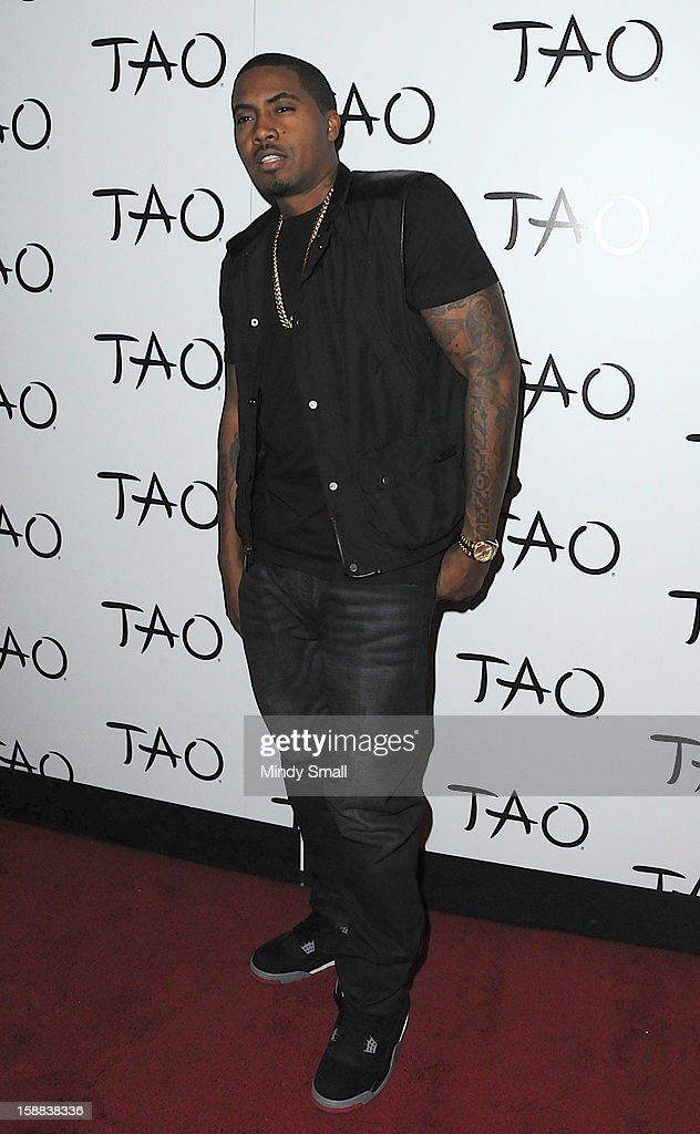 <a gi-track='captionPersonalityLinkClicked' href=/galleries/search?phrase=Nas&family=editorial&specificpeople=204627 ng-click='$event.stopPropagation()'>Nas</a> kicks off New Year's Eve Weekend at Tao Nightclub on December 28, 2012 in Las Vegas, Nevada.