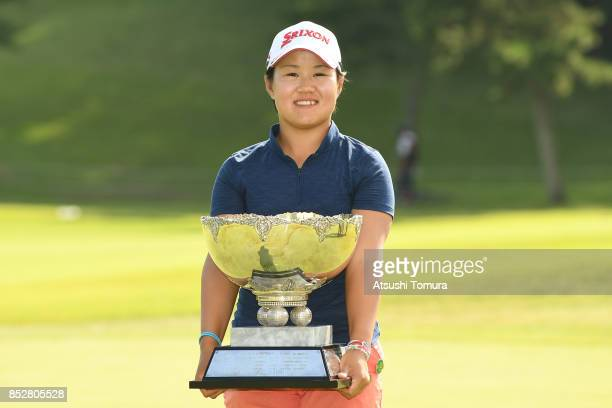 Nasa Hataoka of Japan poses with the trophy after winning the Miyagi TV Cup Dunlop Ladies Open 2017 at the Rifu Golf Club on September 24 2017 in...