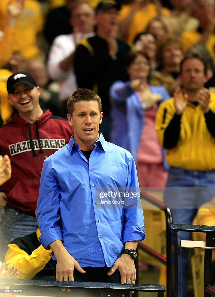 Nascar driver <a gi-track='captionPersonalityLinkClicked' href=/galleries/search?phrase=Carl+Edwards+-+Racecar+Driver&family=editorial&specificpeople=193803 ng-click='$event.stopPropagation()'>Carl Edwards</a> is applauded while watching the game between the Arkansas Razorbacks and the Missouri Tigers at Mizzou Arena on March 5, 2013 in Columbia, Missouri.