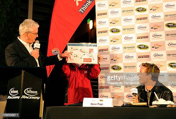 Nascar driver/2011 Daytona 500 Winner Trevor Bayne is presented with a road map of the course at Infineon Raceway by Steve Page President and General...