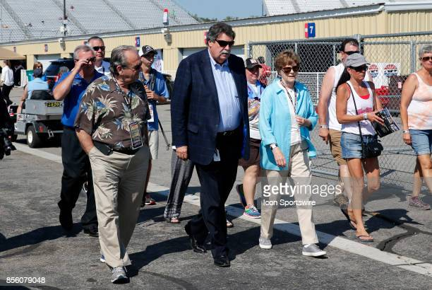 Nascar president Mike Helton walks with NH senator Jeanne Shaheen to the driver's meeting before the Monster Energy Cup Series ISM Connect 300 on...