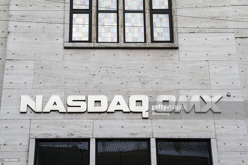 A Nasdaq OMX sign sits on display outside the Copenhagen Stock Exchange in Copenhagen, Denmark, on Friday, Jan. 25, 2013. Danish regional banks are struggling to emerge from a burst property bubble that's forced the government resolution agency to take over a dozen lenders after losses on commercial and agricultural loans wiped out capital. Photographer: Freya Ingrid Morales/Bloomberg via Getty Images