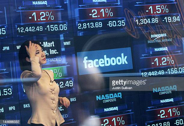 Nasdaq television reporter is seen inside the Nasdaq studios as the Facebook logo is displayed on a ticker board on May 17 2012 in New York City...