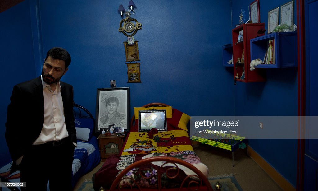 Naseer Ahmad Nowruzee stand in the bedroom of his 9 yr-old son, Ali Sena Nowruzee, at his home on April 9, 2013 in Herat, Afghanistan. The family paid $65,000 ransom to kidnappers only to find that the boy was murdered by the men who took him, including a family body guard. Herat's relative success economically have caused hundreds of kidnappings, with families of businessmen paying large sums to ransom their relatives.