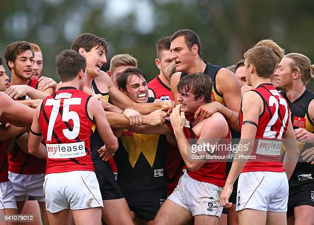 Nash Holmes of Essendon and players wrestle during the round 11 VFL match between Werribee and Essendon at Avalon Airport Oval on June 18 2016 in...