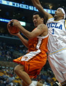 JS Nash of Oregon State is defended by Dijon Thompson of UCLA during 7972 firstround victory in the Pacific Life Pac10 men's basketball tournament at...