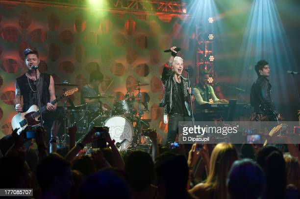Nash Overstreet Jamie Follese Ryan Follese and Ian Keaggy of Hot Chelle Rae perform at a 'Crazy Good VMA Concert Event' presented by MTV and Pop...