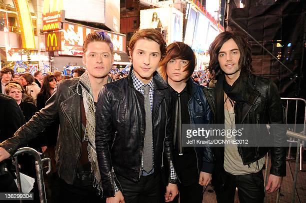Nash Overstreet Ryan Follese Jamie Follese and Ian Keaggy of Hot Chelle Rae pose during Dick Clark's New Year's Rockin' Eve with Ryan Seacrest 2012...