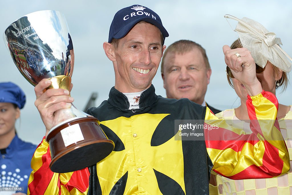 <a gi-track='captionPersonalityLinkClicked' href=/galleries/search?phrase=Nash+Rawiller&family=editorial&specificpeople=223869 ng-click='$event.stopPropagation()'>Nash Rawiller</a> poses with the trophy after Kirramosa won Race 6 the Crown Oaks during Oaks Day at Flemington Racecourse on November 7, 2013 in Melbourne, Australia.