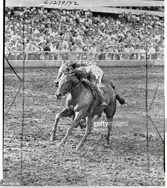 Nashua with Eddie Arcaro aboard is shown beating out Blue Lem Chris Rogers up in the stretch to win the rich Florida derby on a sloppy turf at...