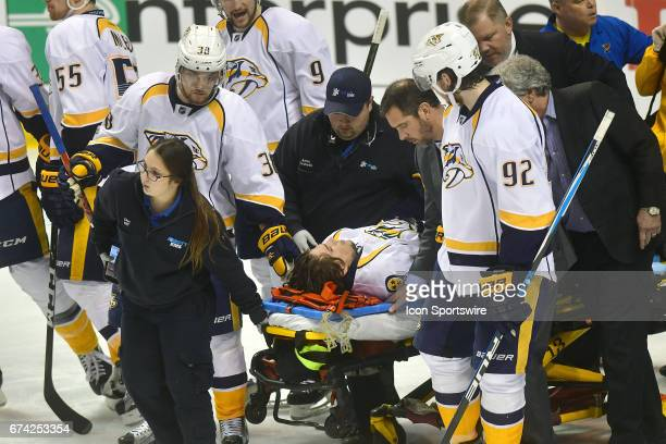Nashville leftwing Kevin Fiala is wheeled out on a stretcher after suffering a leg injury early in the second period during game 1 of the second...