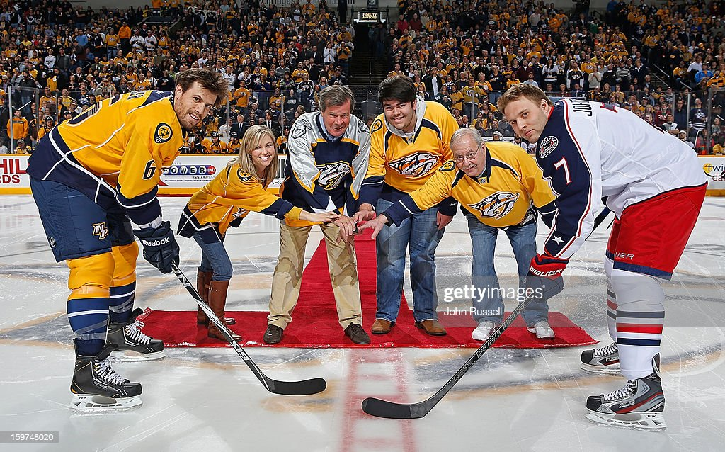 Nashville Mayor Karl Dean along with season ticket holders drop the puck for Shea Weber #6 of the Nashville Predators against Jack Johnson #7 of the Columbus Blue Jackets during an NHL game at the Bridgestone Arena on January 19, 2013 in Nashville, Tennessee.