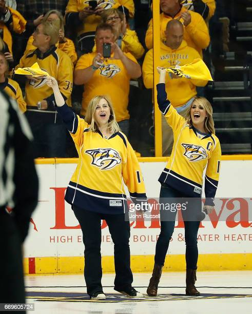 Nashville mayor Megan Barry left and country music singer Carrie Underwood excite the fans prior to Game Three of the Western Conference First Round...