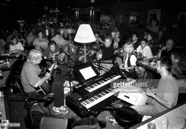 Nashville musicians and songwriters perform 'in the round' at a live music venue in Nashville Tennessee in 2001 Among the performers are Al Anderson...