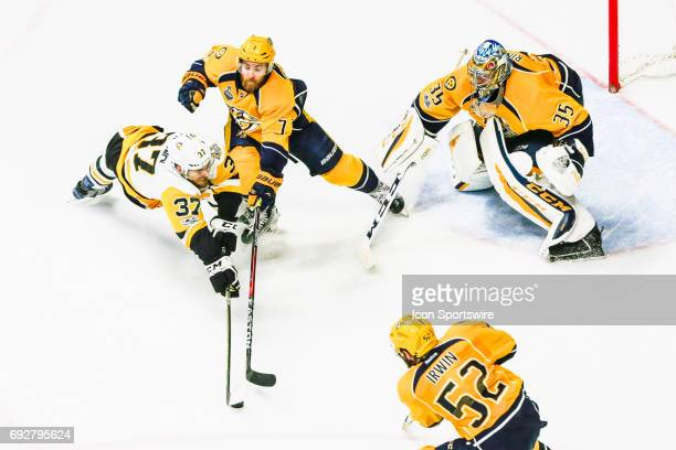 Nashville players converge on Pittsburgh Penguins right wing Carter Rowney during game 4 of the 2017 NHL Stanley Cup Finals between the Pittsburgh...
