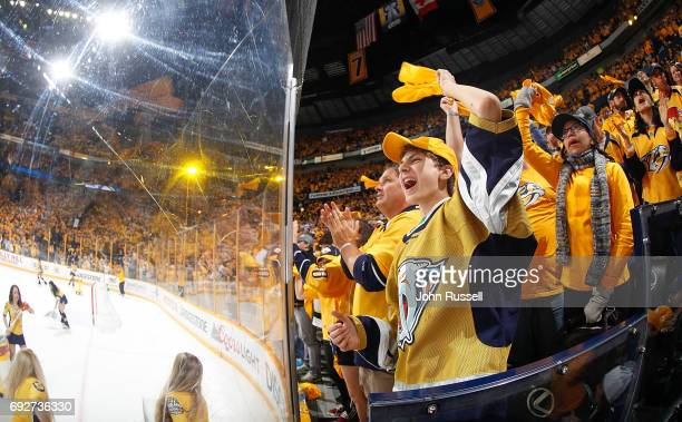 Nashville Predator fans cheer during Game Four of the 2017 NHL Stanley Cup Final at Bridgestone Arena on June 5 2017 in Nashville Tennessee