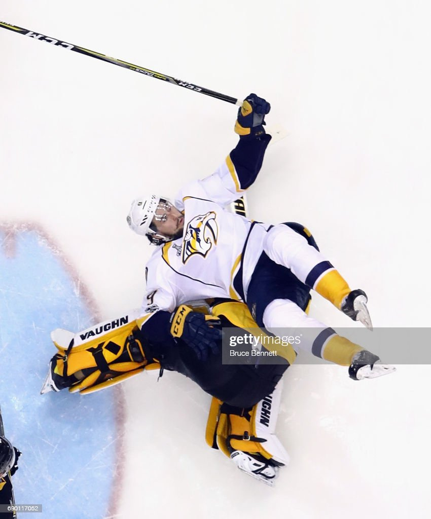 Nashville Predators center Filip Forsberg #9 flips over Pittsburgh Penguins goalie Matt Murray #30 during Game One of the 2017 NHL Stanley Cup Final at the Consol Energy Center on May 29, 2017 in Pittsburgh, Pennsylvania. The Penguins defeated the Predators 5-3.