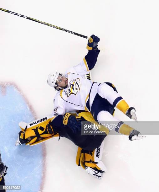 Nashville Predators center Filip Forsberg flips over Pittsburgh Penguins goalie Matt Murray during Game One of the 2017 NHL Stanley Cup Final at the...
