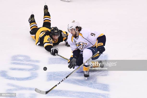Nashville Predators center Filip Forsberg plays the puck around a fallen Pittsburgh Penguins center Scott Wilson during the first period Game Five...