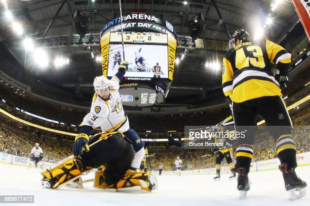Nashville Predators center Filip Forsberg trips over Pittsburgh Penguins goalie Matt Murray during the third period in Game One of the 2017 NHL...