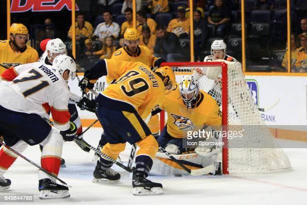 Nashville Predators center Frederick Gaudreau shields the puck so that Nashville Predators goalie Pekka Rinne can make a save during the second...