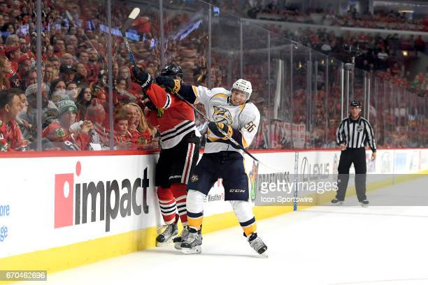 Nashville Predators center Kevin Fiala collides with Chicago Blackhawks right wing Richard Panik into the boards in the second period during game 2...