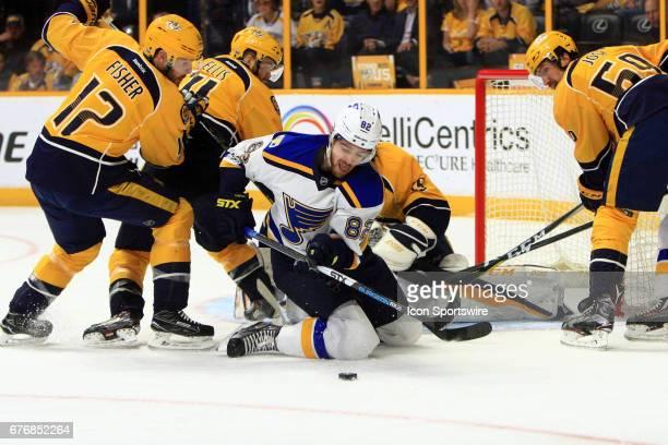 Nashville Predators center Mike Fisher goalie Pekka Rinne defenseman Ryan Ellis and defenseman Roman Josi defend against St Louis Blues left wing...