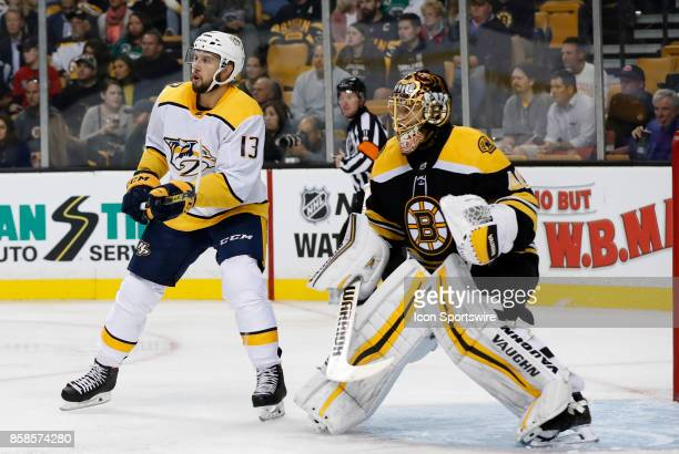 Nashville Predators center Nick Bonino camps out in front of Boston Bruins goalie Tuukka Rask on the power play during an NHL game between the Boston...