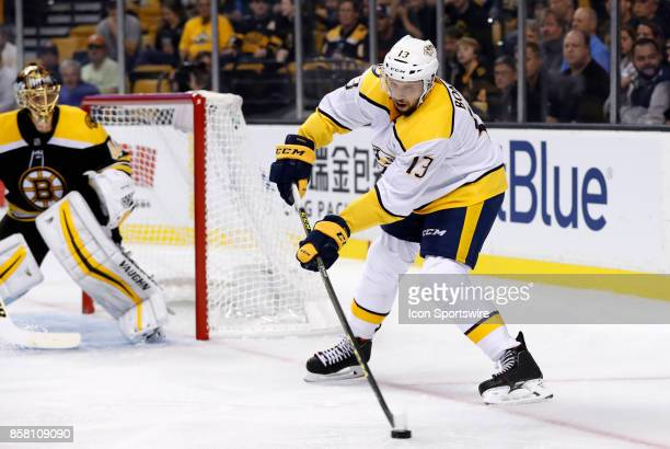 Nashville Predators center Nick Bonino holds the puck down low on the power play during an NHL game between the Boston Bruins and the Nashville...