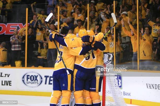 Nashville Predators center Nick Bonino Predators center Austin Watson and Predators defenseman Mattias Ekholm congratulate goalie Pekka Rinne at the...