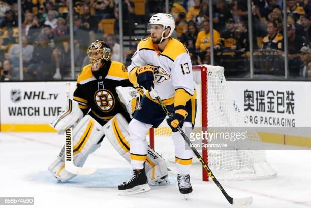 Nashville Predators center Nick Bonino sets up to the side of Boston Bruins goalie Tuukka Rask on the power play during an NHL game between the...