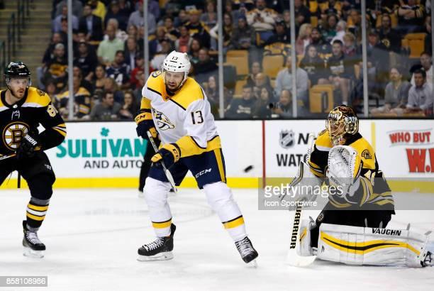 Nashville Predators center Nick Bonino tips the puck on Boston Bruins goalie Tuukka Rask during an NHL game between the Boston Bruins and the...