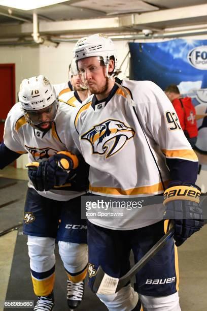 Nashville Predators Defenceman PK Subban and Nashville Predators Center Ryan Johansen bump into each other before taking the ice in a game between...