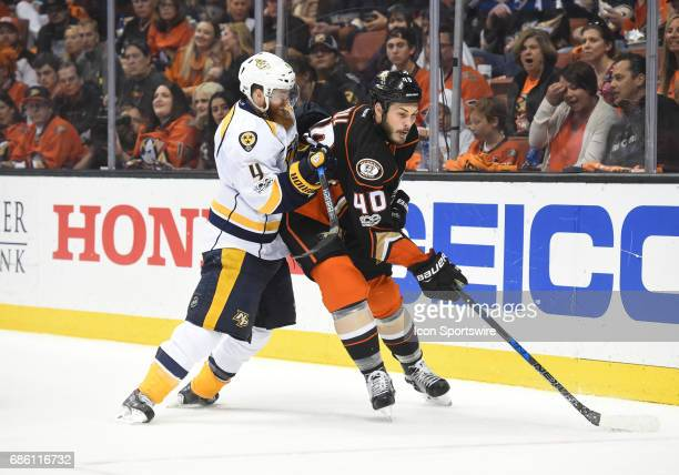 Nashville Predators Defenceman Ryan Ellis checks Anaheim Ducks Right Wing Jared Boll during game 5 of the 2017 NHL Western Conference Final between...