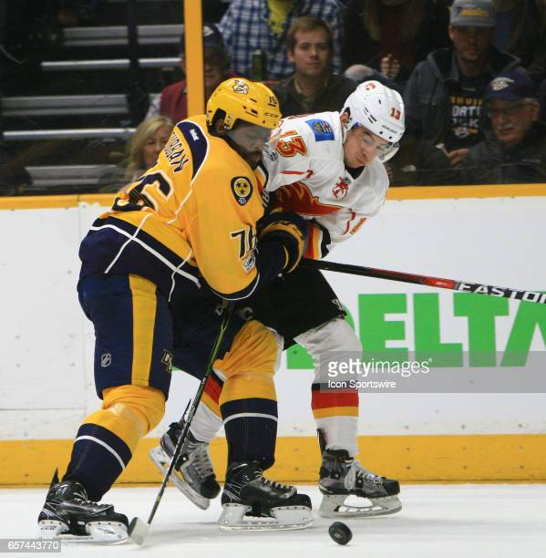 Nashville Predators defenseman PK Subban and Calgary Flames left wing Johnny Gaudreau battle for the puck during the NHL game between the Nashville...