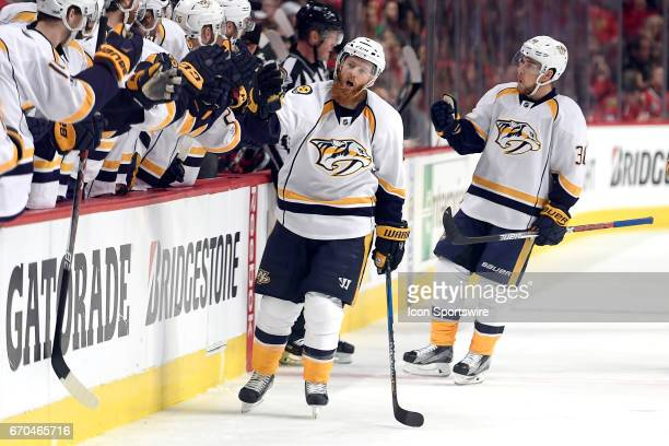 Nashville Predators defenseman Ryan Ellis celebrates with teammates after scoring a goal in the first period during game 2 of the first round of the...