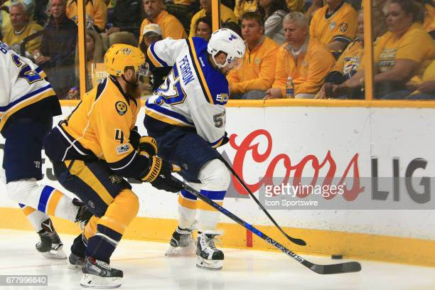 Nashville Predators defenseman Ryan Ellis challenges St Louis Blues right wing David Perron for the puck during Game Four of Round Two of the Stanley...