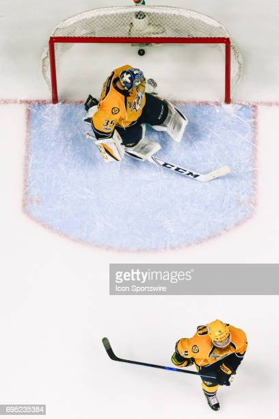 Nashville Predators defenseman Ryan Ellis skates away as Nashville Predators goalie Pekka Rinne looks away from winning goal during game 6 of the...