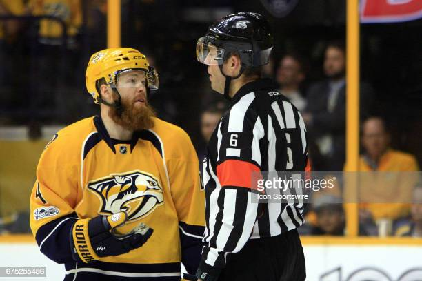 Nashville Predators defenseman Ryan Ellis talks with referee Francis Charron following a penalty against Nashville Predators defenseman Matt Irwin...