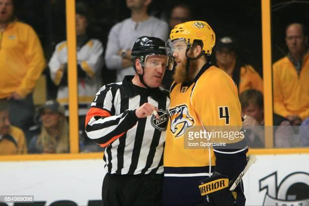 Nashville Predators defenseman Ryan Ellis talks with referee Kelly Sutherland during Game Four of the Western Conference Final between the Nashville...