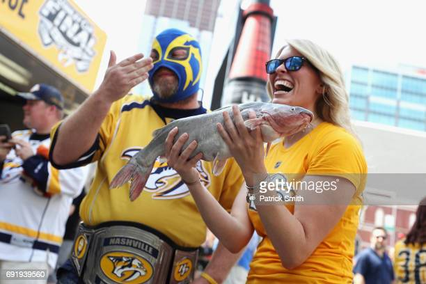 Nashville Predators fan holds a catfish prior to Game Three of the 2017 NHL Stanley Cup Final between the Pittsburgh Penguins and the Nashville...