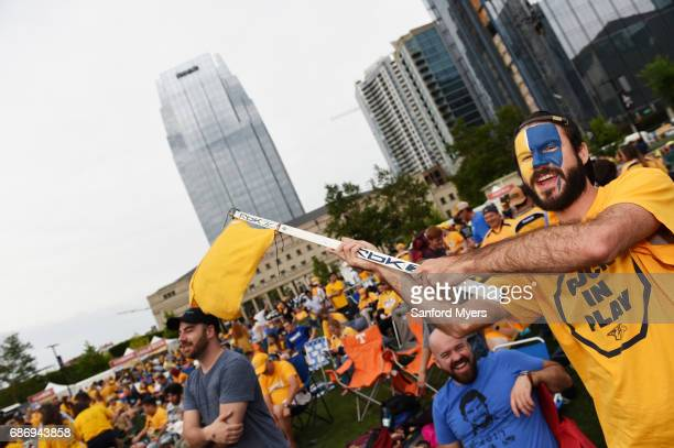 Nashville Predators fan Luke Maas waves a flag prior to Game Six of the Western Conference Final between the Nashville Predators and the Anaheim...